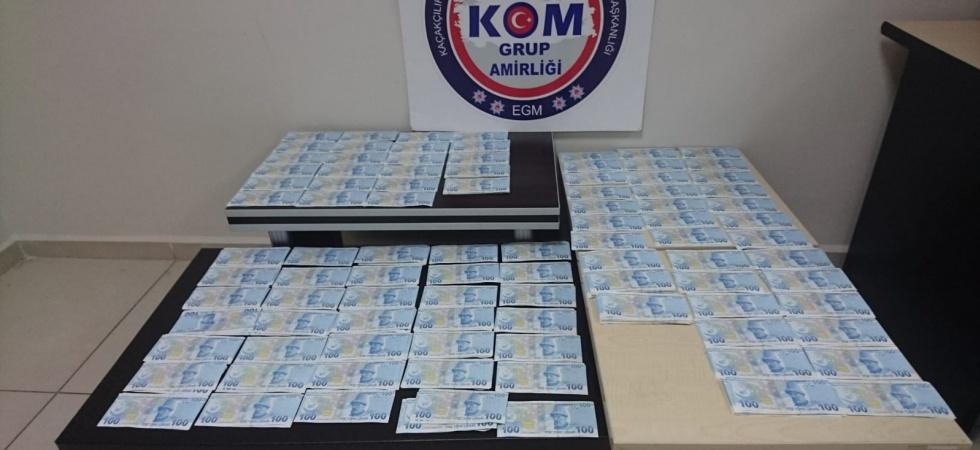 Uyuşturucu araması yapılan araçtan 57 bin lira sahte para çıktı
