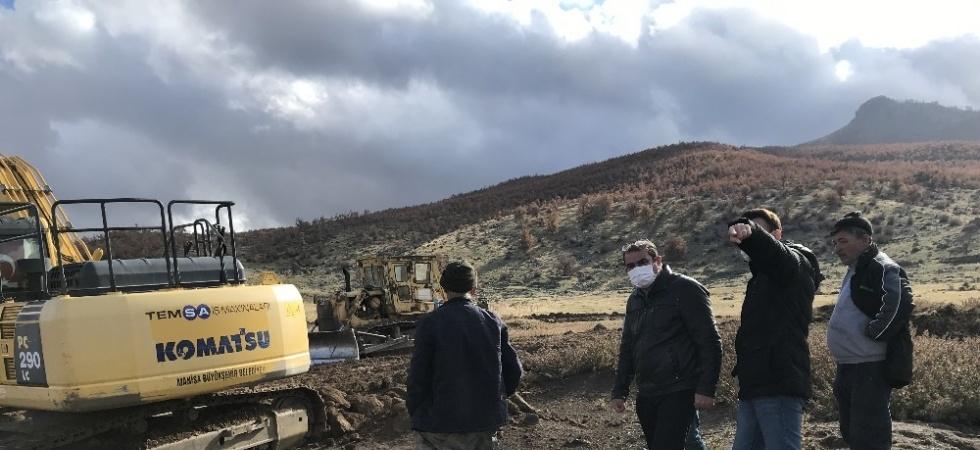 Tavak'ta tarımsal sulama göleti temizleniyor